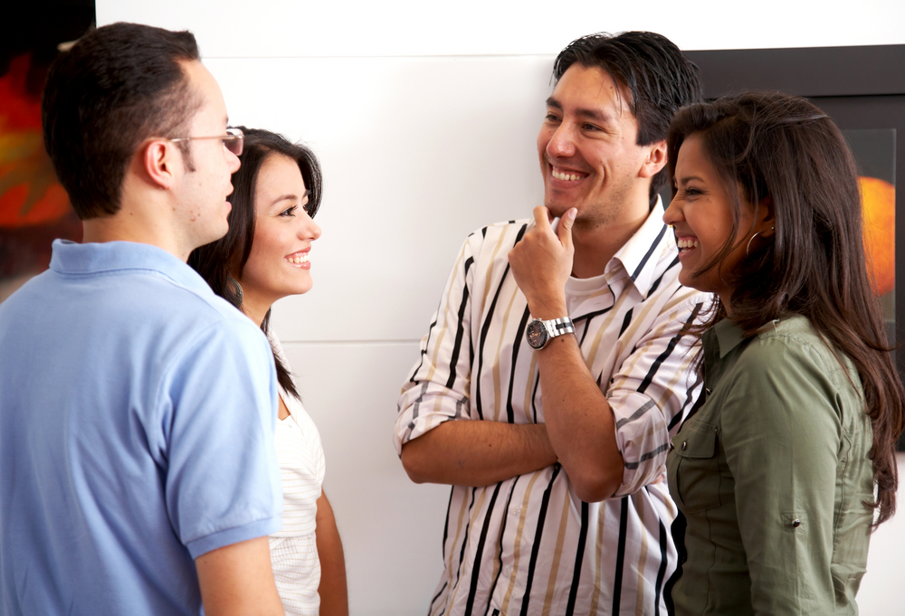 group of friends in an apartment talking